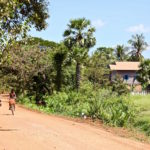 kids riding bikes in Cambodia