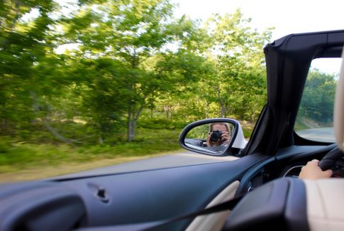 Brianne Miers driving through Acadia National Park