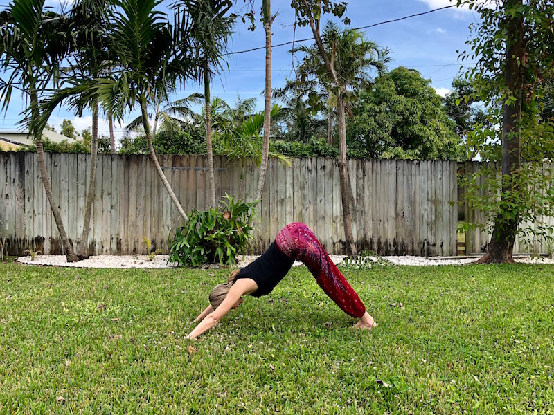 Brianne Miers doing yoga in One Tribe Apparel boho harem pants